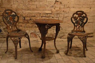 rusty antique steel  garden table and chairs prior to blasting & painting