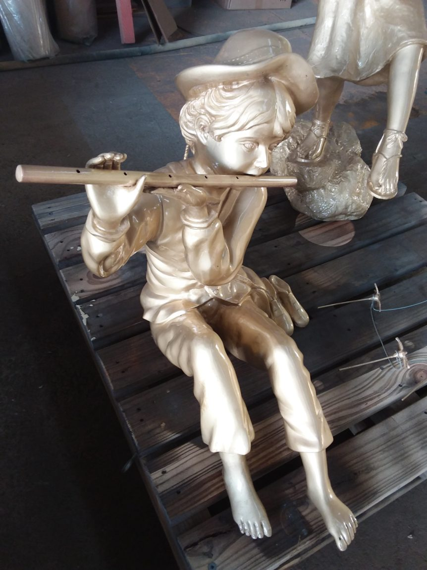 Boy & pipe statue after glass bead blasting and protective coating
